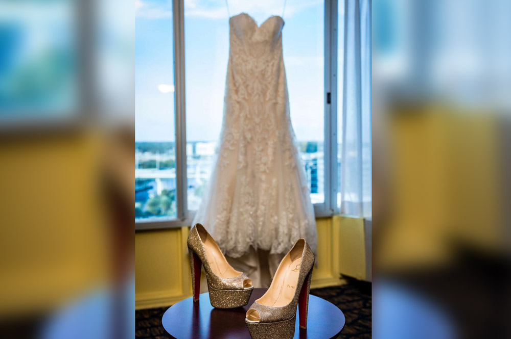Sparkling gold shoes and wedding dress in window